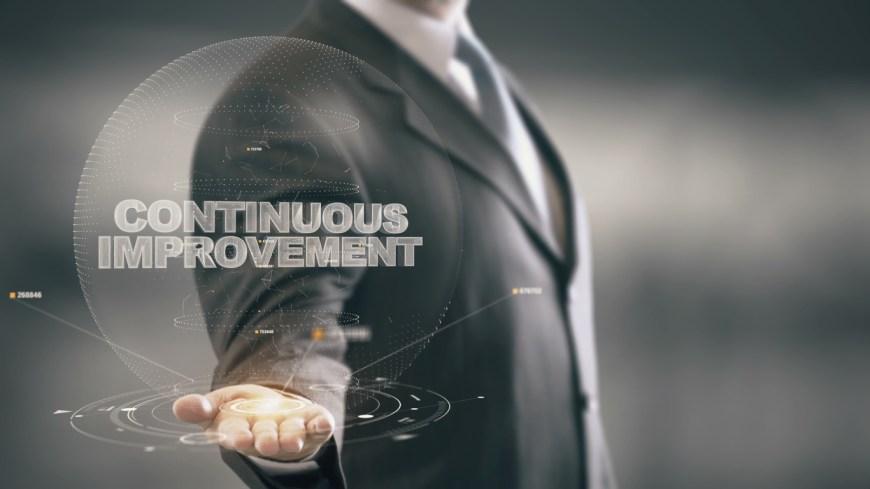 Continuous Improvement with hologram businessman concept