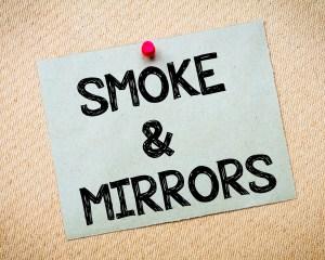 Smoke and mirrors written on sticky note
