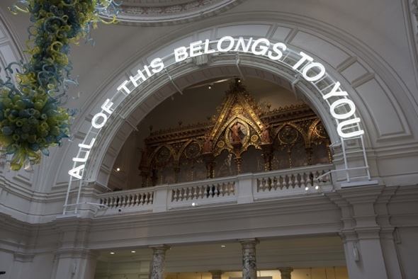 A neon sign in the V&A's grand entrance introduces the All of This Belongs to You exhibition (1st April – 19th July). © Peter Kelleher/Victoria & Albert Museum, London 2015