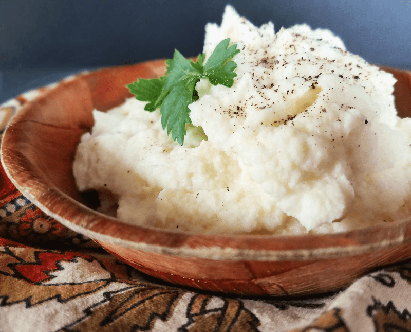If you're looking for a super easy recipe for low carb cauliflower mash, you've found it. This Mashed Cauliflower only takes 15 minutes to prepare, and it's so creamy and delicious! Thanks to clean ingredients, it's Paleo, vegan, low-carb, keto and Whole30 friendly, too.