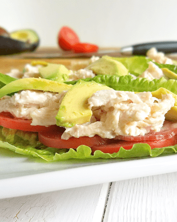 closeup photo of BLTA chicken lettuce wrap on a plate