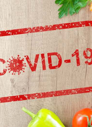 graphic of COVID-19 on a cutting board with a knife and vegetables
