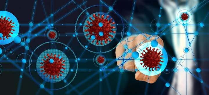 digital images of coronavirus with a fist in the background