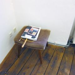 The Big Low Down // Chair, Kronen Zietung Newspaper and wooden reader, Print of Painting 'The Big Low Down (Kathryn Bigelow shits on Leni Riefenstahl's Grave)', Print of Text 'Doomsday Seed Vault' by F. William Engdahl, Permanent Marker // 40x50x30cm. 2013