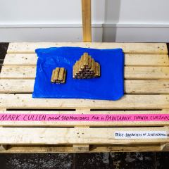 Golden Mars Bar Offering* // Spray Paint, Є 100 worth of Mars Bars // 150 x 100 x 150 cm // 2010