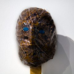Asphyxiated Idol* // Wood, Cling Film, Blue Mint Sweets, Є 100 worth of Mars Bars // 150 x 100 x 150 cm // 2010