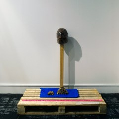 Fork Lift Alter to the False Idol* // Pallett, Wood, Screws, Tape, Cling Film, Plastic, Spray Paint, Blue Mint Sweets, Є 100 worth of Mars Bars // 150 x 100 x 150 cm // 2010