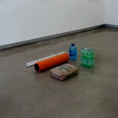Contemporary Art disguised as Aid disguised as Contemporary Art // Bag of Cement, Plastic Plumbing Pipes, Bottled Water, Tie Wraps // Dimensions Variable // 2008