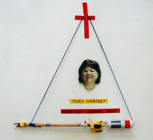 Mary Harney Work Harder Electric Prod // Wood, Electrical Wire, Battery Pack, LED, Switch, Tape, Foam, Cord, Digital Print // 110 x 100 cm// 2005