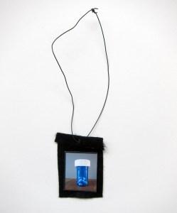 Blue Pill Popping (Meditated Media Medals) // Laminated Digital Print, Felt, Eyelet, Glue, Wire // 10 x 7 cm // 2016