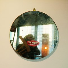 Self Portrait to put a Smile on your Face // Mirror, Acrylic Paint // 60 x 60 cm // 2006