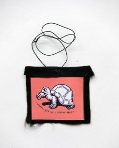 Fabian Wagging Turtle Tales (Meditated Media Medals) // Laminated Digital Print, Felt, Eyelet, Glue, Wire // 7 x 10 cm // 2016