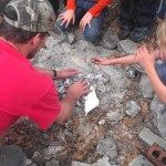 Learning to build a campfire on a co-op camping trip.