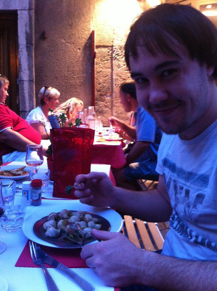 Dan eating snails in France