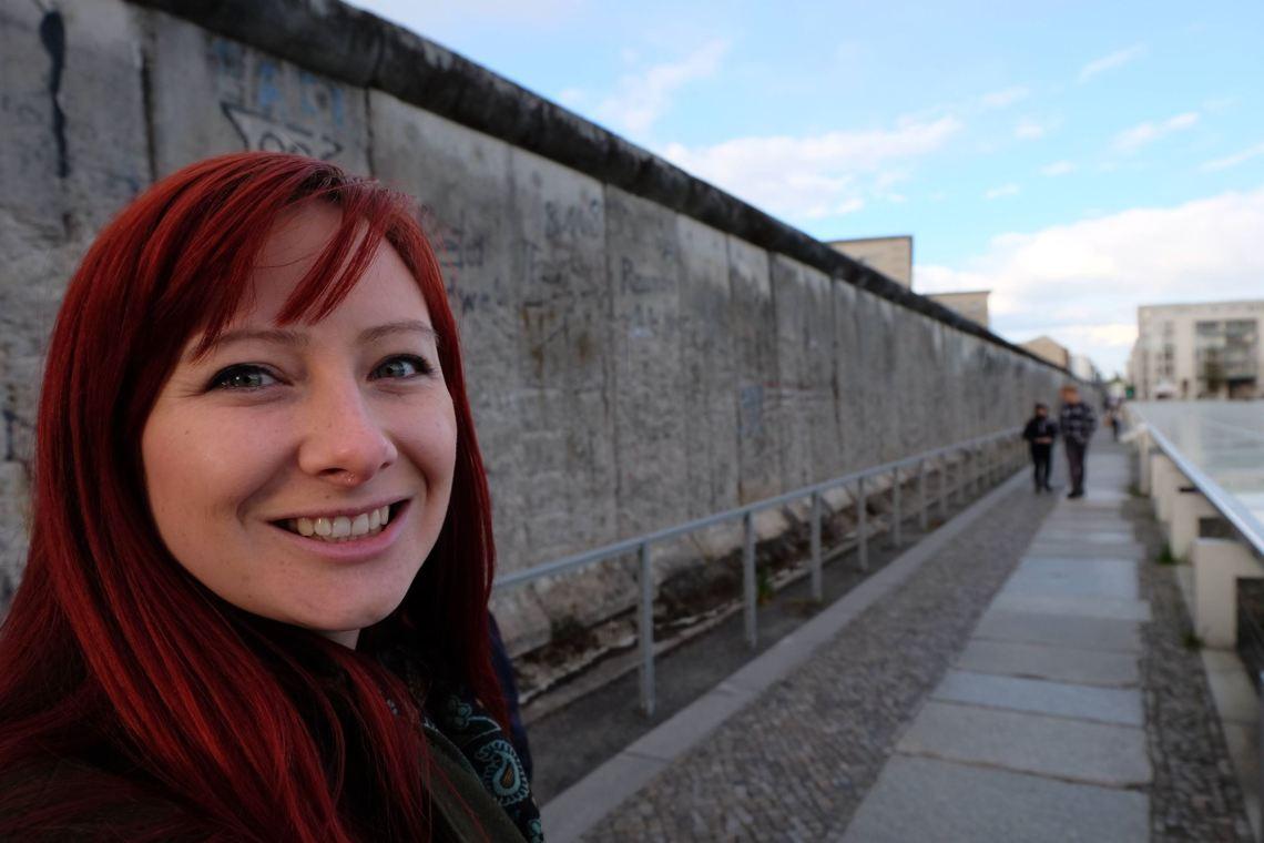 Jacqui at the Berlin Wall