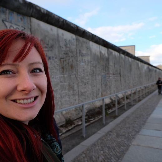 Jacqui at the Berlin Wall