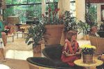 Old pic of the Outrigger hotel lobby, with folks reluctantly sporting leis.