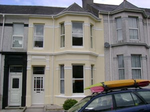 A Terraced House In Plymouth Painted With Wall Coating