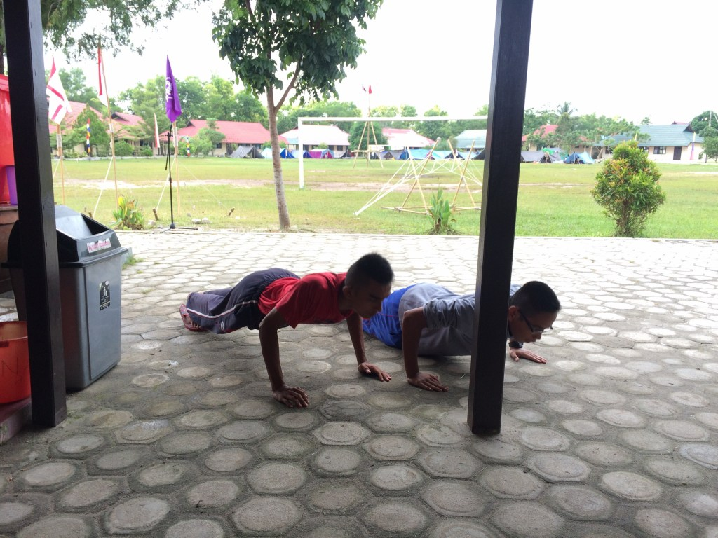 Two boys being punished by the teachers...