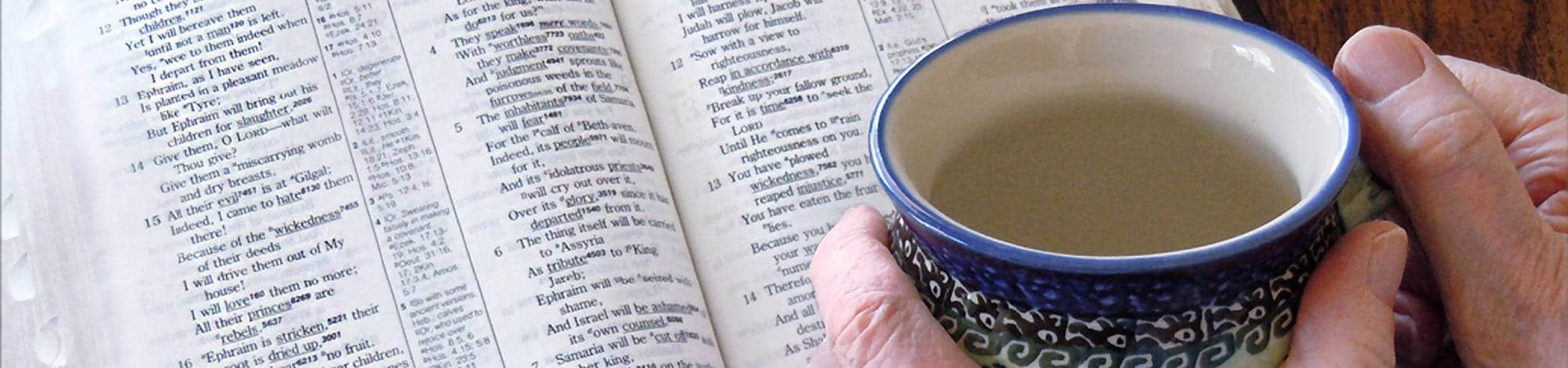 Woman With Bible and Coffee Cup
