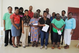 Some of the WISE grants recipients pose for a group with Hon Nisbett and PEP staff