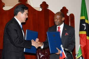 Prime Minister, the Rt. Hon. Dr. Denzil L. Douglas (right) and His Excellency President Ma Ying-jeou shake hands after signing the communique