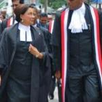 Chief Justice Ivor Archie (R) and Prime Minister Kamla Persad-Bissessar walking next to each other at the opening of the law term in Trinidad and Tobago on Monday. Photo: OPM