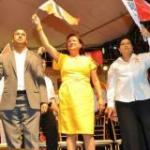 Prime Minister Kamla Persad-Bissessar flanked by Congress of the People chair Carolyn Seepersad-Bachan to her left and San Fernando Mayor Navid Muradali at a local government campaign meeting