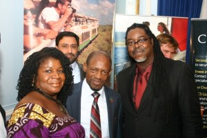 Two business leaders pose with St. Kitts and Nevis' Prime Minister the Rt. Hon. Dr. Denzil L. Douglas.