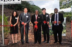 (Cutting of the ribbon) Left to right -    CEO of T-Loft Property Development, Ms. Ins Zhao; T-Loft Property Development President, Mr. Tammas Tang; St. Kitts and Nevis' Prime Minister the Right Hon. Dr. Denzil L. Douglas; Chairman of T-Loft Property Development, Mr. Leo Zeng and T-Loft Property Development attorney, Mr. Anthony Johnson
