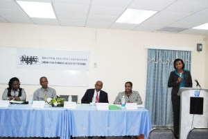 National Housing Corporation's General Manager, Ms Judith Rawlins (standing right), addresses the press conference. Others in the picture from left are Ms Eslyn Swanston, Dr Osbert Liburd, Hon Dr Earl Asim Martin, and Ms Alethea Gumbs.