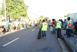 Bringing up the rear: After all the troupes would have streamed down, the unregistered SWMC Troupe falls in line, not to play mas, but to clean the streets.