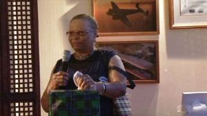 """Ms. Elvira """"Fairy"""" Clarke served for 22 years at the Vance W. Amory International Airport as a cleaner during a send off ceremony in her honour at the airport on December 30, 2013"""