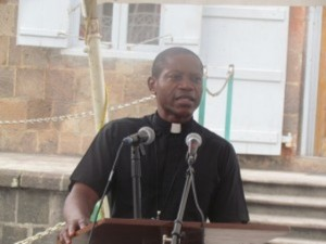 Chairman of the NCC, Father Alric Francis during prayer service at the War Memorial Square in Charlestown.