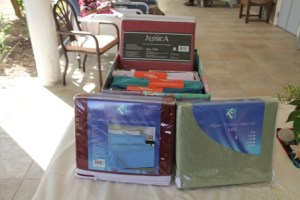 Sheet sets donated to the Flamboyant Nursing Home on February 12, 2014 from the Bank of Nevis Social Club