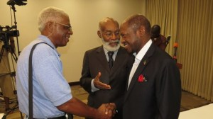 Mr. J. S. Archibald Q.C. (center) introduces long friend and prominent BVI businessman; Mr. Elihu Rhymer (left) to Prime Minister the Right Hon. Dr. Denzil L. Douglas during a Town Hall Meeting the Prime Minister hosted in Tortola on February 7th 2014.