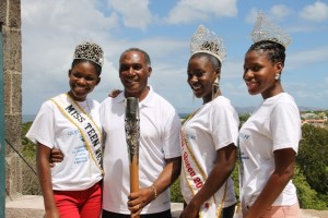 : Premier of Nevis Hon. Vance Amory, Miss Teen Nevis Irveeka Nisbett, Miss Culture Jomelle Elliott and Miss Culture Swimwear Cherissa Maynard display Queen's Baton at the Apron of the Nevis Island Administration Building at Bath Plain