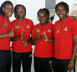 Four female Footballers from Nevis