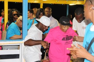 : Members of The UK Invasion, a group from England visiting Nevis for the Homecoming Celebrations and Culturama 40 Celebrations disembark from the MV Prince Devonte J at the Charlestown Pier on Nevis on the evening of July 29, 2014