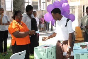 Director of the Department of Statistics and Economic Planning Doriel-Tross Phillip with a student of the Nevis Sixth Form College, at the Careers in Statistics Awareness and Education Fair at the Memorial Square in Charlestown on October 15, 2014