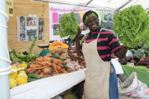 Award-winning Nevis farmer Emontine Thompson showing off her produce on display at the Department of Agriculture's Open Day 2015 at the Villa Grounds in Charlestown on the second day of the two-day event on March 27, 2015