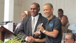 Premier of Nevis Hon Vance Amory presenting Chairman of Gulf Insurance Limited Jason Clarke with an award at the Gulf Insurance Inter-Primary Schools Championship Opening CeremonyElquemedo T. Willett Park on April 01, 2015