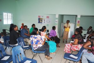 Ms Gloria Mills talking to the parents at the St. Johnston's Community Centre.