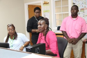 Staff at the Electoral Office on Nevis (L-R front row) Assistant Registration Officers Ernestine Rawlins and Fern Hanley-Jacobs. (L-r back row) Zavier Morrishaw from the Electoral Office in St. Kitts and Mark Mills