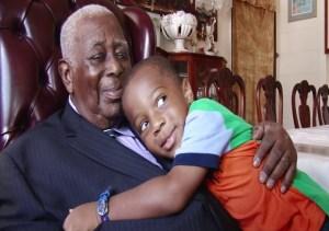 Sir Cuthbert receives a hug from one of his grandchildren