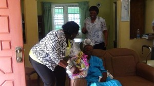 Hon Brandy Williams presents to Florence Liburd