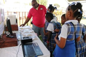 Rohan Claxton, Livestock Extension Officer in the Department of Agriculture explains dry season livestock production to students of the St. James' Primary School at the Ministry of Agriculture Open Day at the Villa Grounds in Charlestown on March 17, 2016