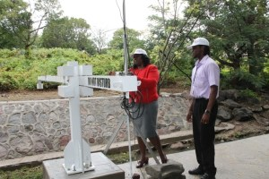 Personnel from the Nevis Disaster Management Department (l-r) Gracelyn Elliott, Community Liaison Officer and Jamal Jean-Jacques of the Communications Unit checking the flood level recorder at Bath Stream on April 06, 2016. The equipment is a part of the United States Agency for International Development-funded early flood warning project on Nevis