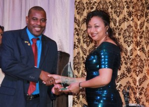 Devon Liburd of the Nevis Tourism Authority receives Ministry of Tourism's 2016 Social Media Award for the Authority from Mrs. Sharon Brantley, wife of the Minister of Tourism Hon. Mark Brantley on behalf of the Ministry of Tourism at the Tourism Awards Gala and Dance at the Four Seasons Resort on May 28, 2016