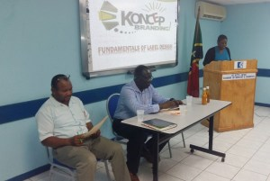 Assistant Secretary in the Ministry of Agriculture, Ms Natasha Daniel, opening the Food Labelling Workshop. On the left is Mr Andy Blanchette of the Ministry of Agriculture, and next to him is Mr Augustine Merchant.